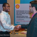A HR representative from Shell Oil greets job-seekers at the NACE convention