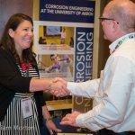A UoA rep greets a NACE member at the BP Career Fair