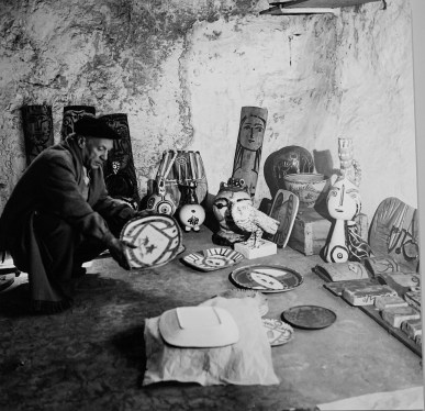 Picasso arranges his ceramic creations, including Woman's Faces (right-hand corner), based on a Cypriot composite vase of the Early Bronze Age, which is on display at the Louver.
