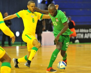 Adrian Chama of Zambia challenged by Renaldo Donnelly of South Africa during the 2016 Futsal African Cup of Nations match between South Africa and Zambia at the Ellis Park Stadium in Johannesburg, South Africa on April 17, 2016 ©Samuel Shivambu/BackpagePix