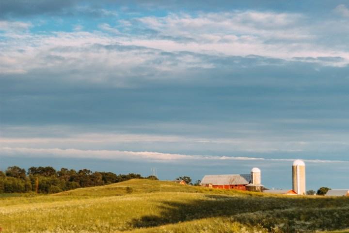clouds-blue-yellow-farm
