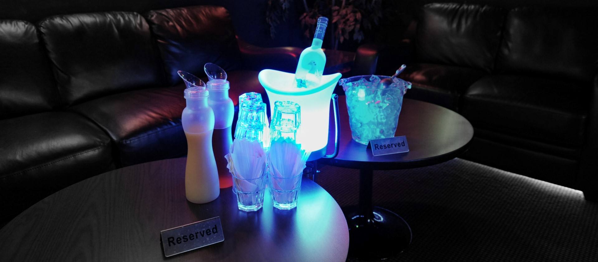 A picture of a nightclub table that is ready for bottle service