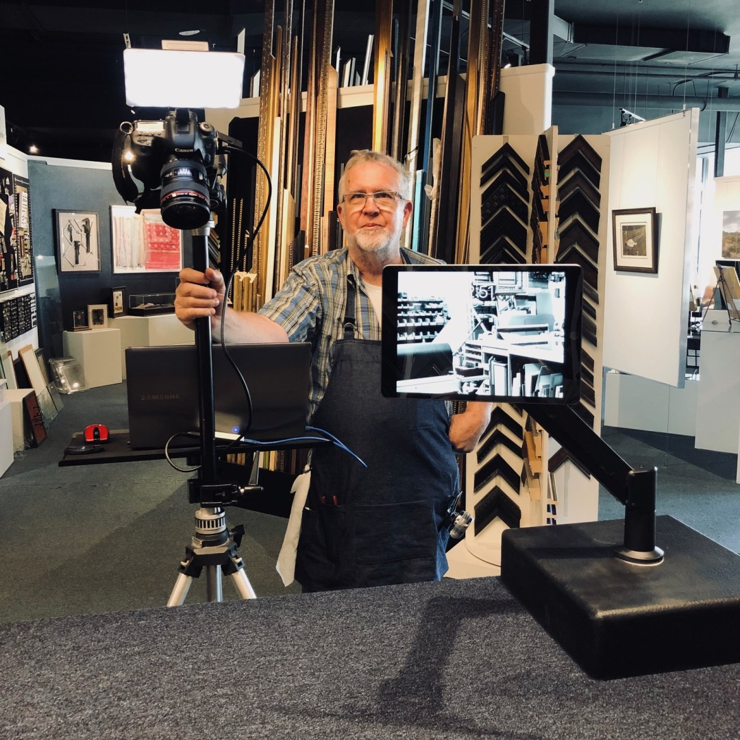 Mo standing with the dual video set up for virtual framing design