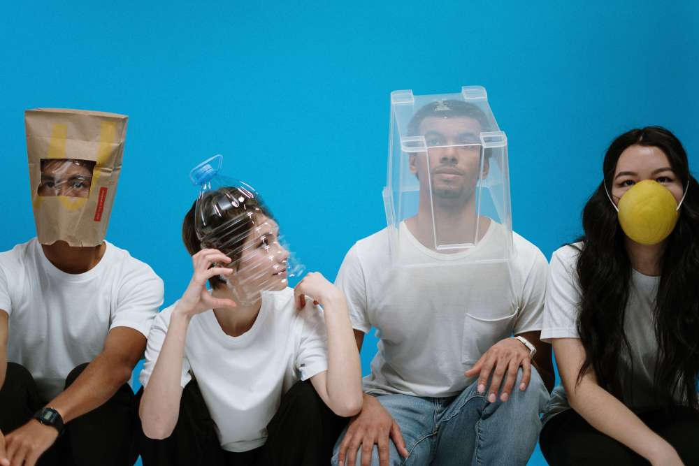 four young adults wearing funny protection masks