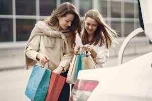 two happy women shopping