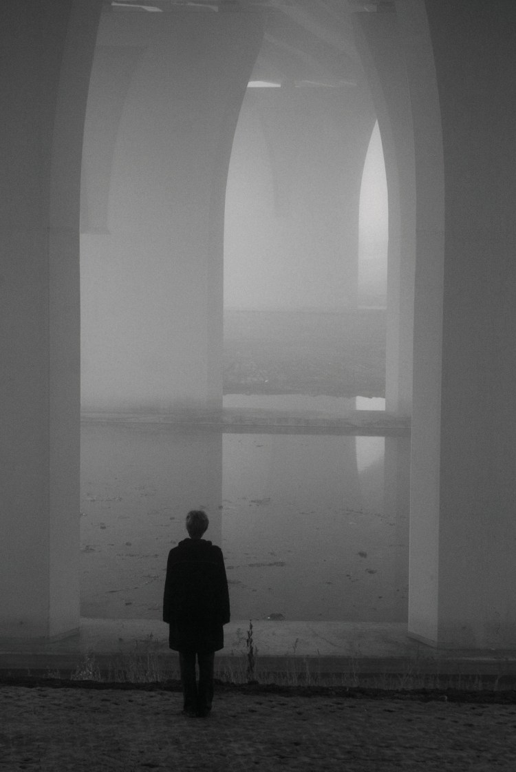 serene photos of a bridge in the fog