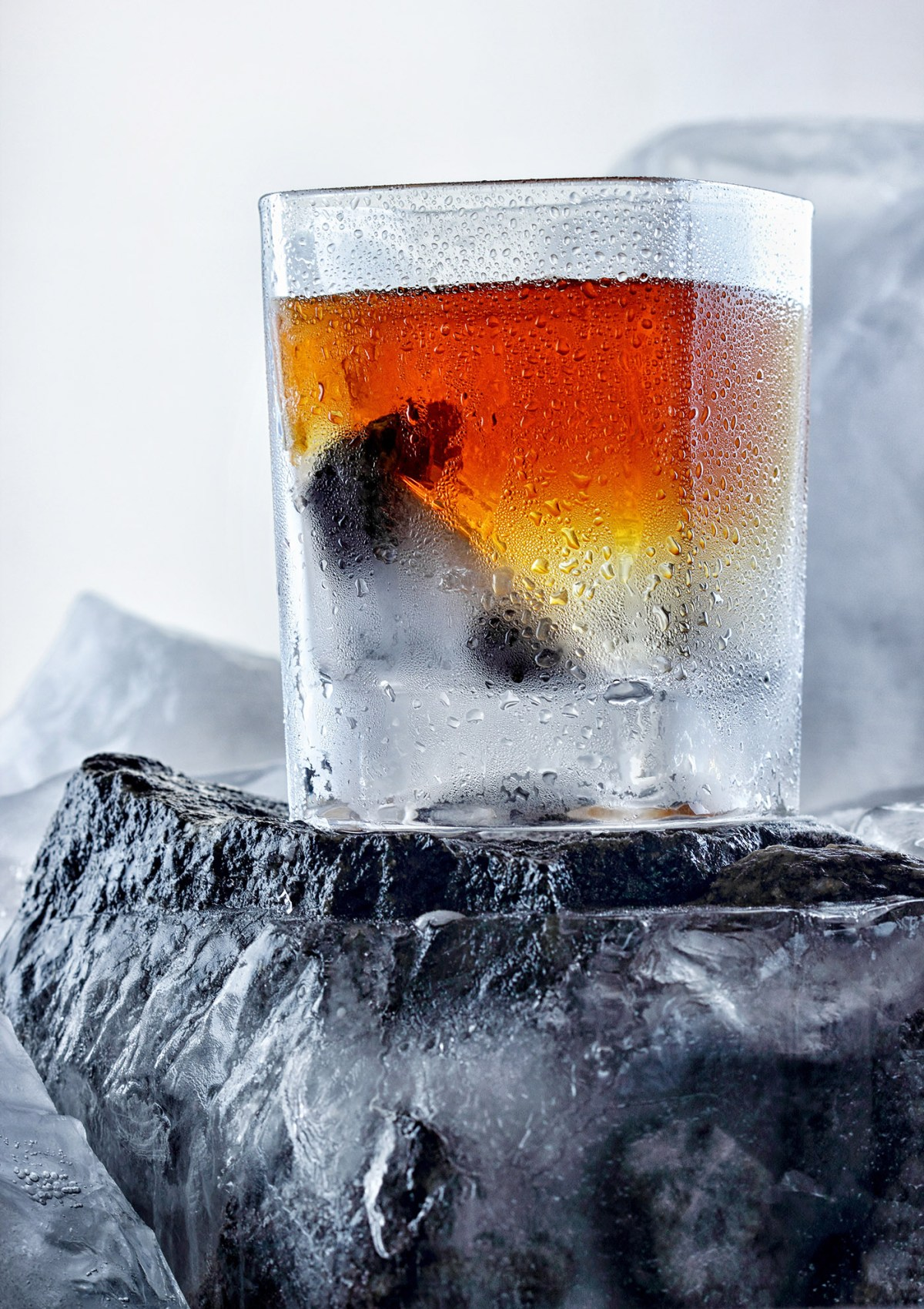 Glass of whiskey. On the iceberg, ice everywhere.Creative photo of alcohol.Advertisng shot.Whiskey wedge