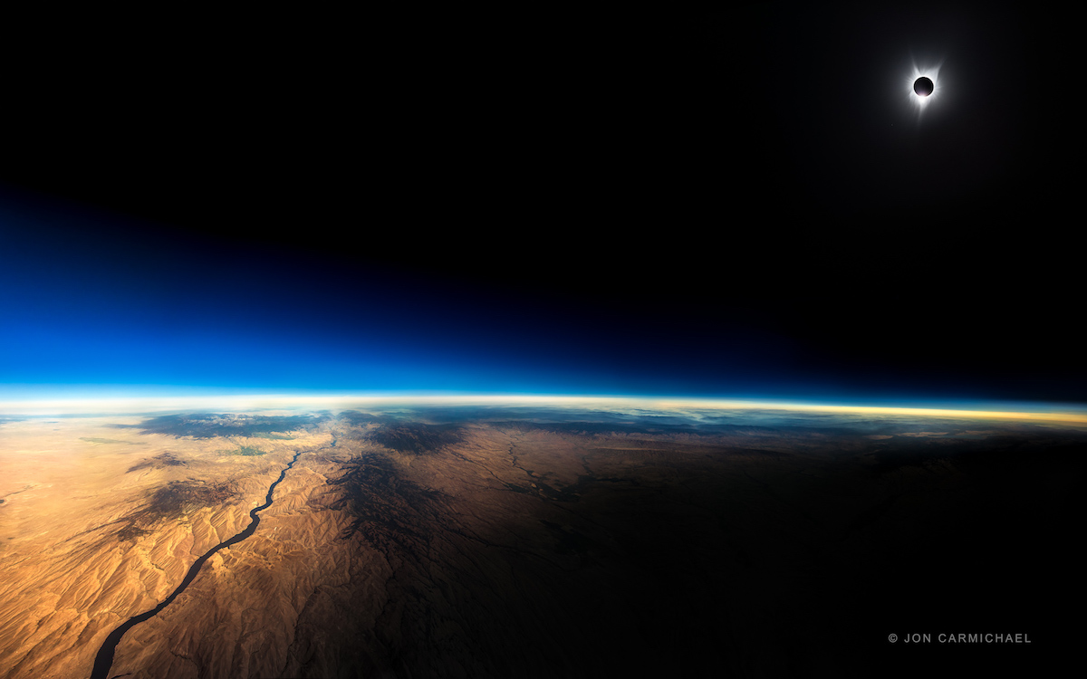 © Jon Carmichael photograph of the Great American Eclipse taken at 39,000 feet over the Oregon and Idaho border.