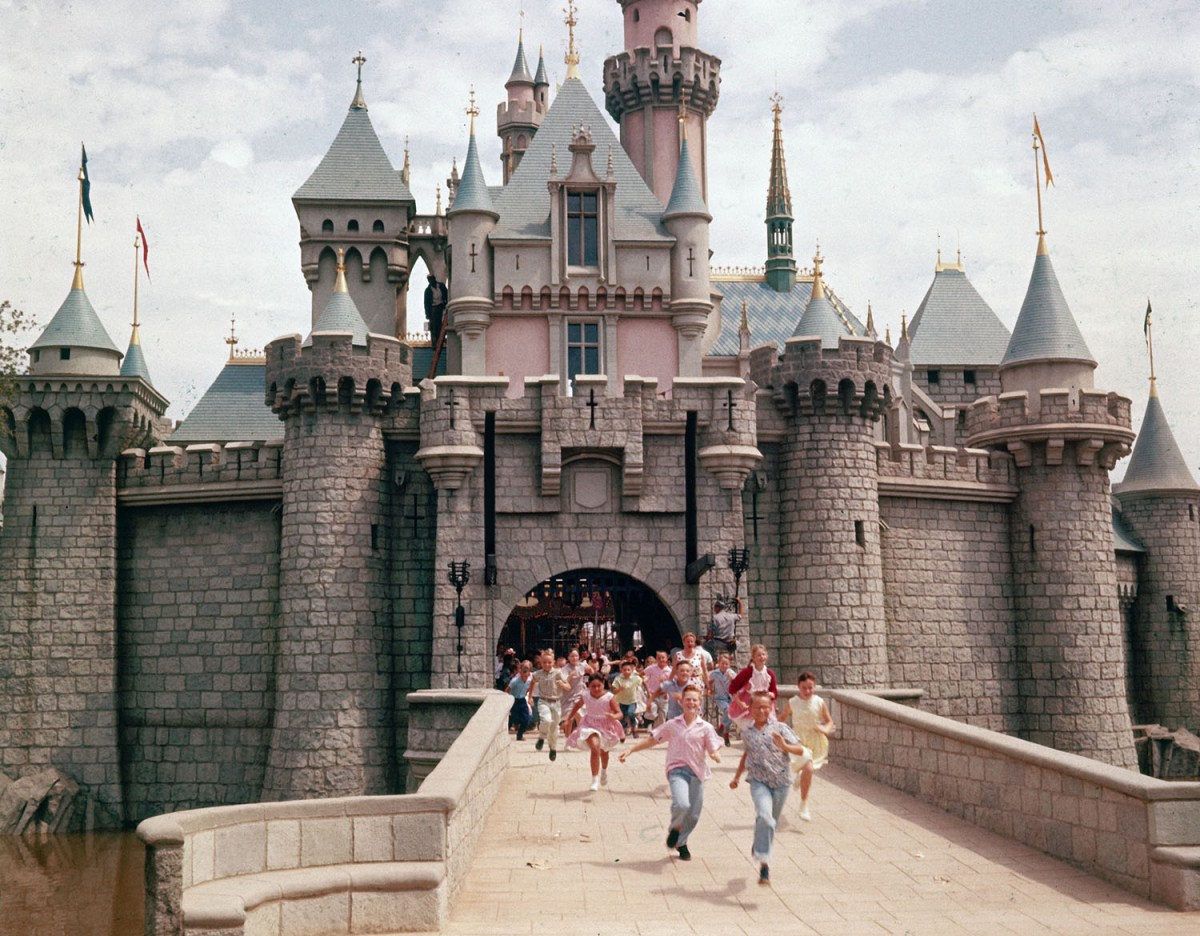 Children running through gate of Sleeping Beauty's