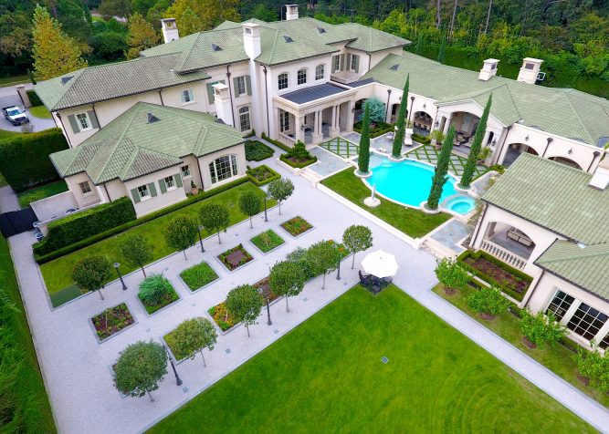 Aerial view captures the various landscaped areas in the backyard. We installed Zoro Zoysia for the lawn around the putting greens.
