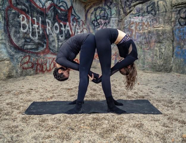 Partner Yoga Standing Wide-Legged Forward Fold