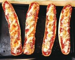 pizza sandwiches on a baking sheet