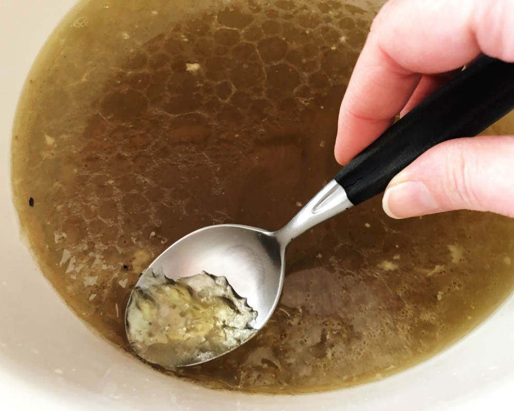 skimming the fat off chicken broth