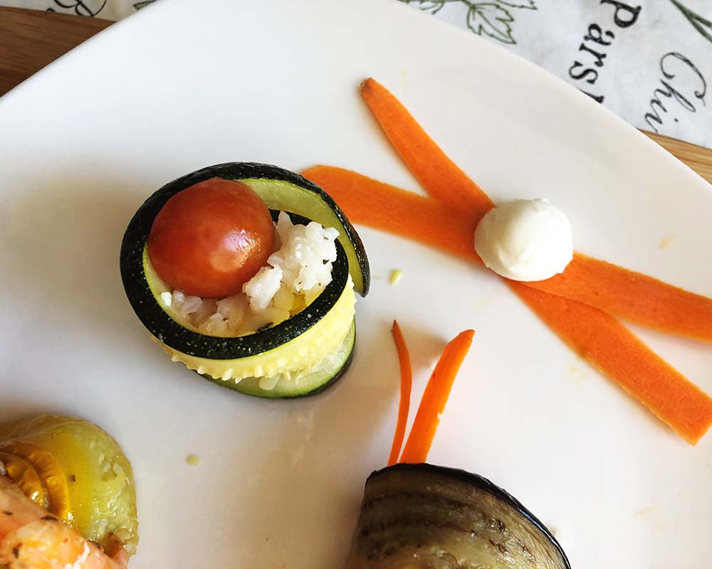 close-up of Zucchini Sushi with cherry tomato