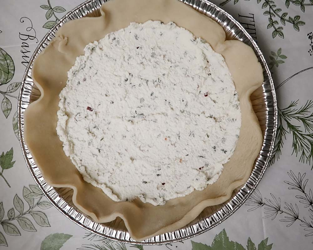 Spreading on the herbed ricotta
