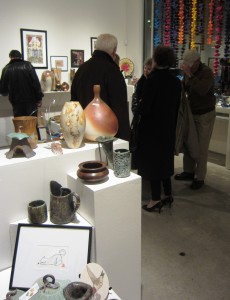 Shoppers browse the Dayton Visual Arts Center's ARTtoBUY holiday gift gallery during December 2011's First Friday.
