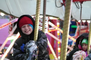 Children can enjoy free carnival rides, games, crafts and more at the Grande Illumination.