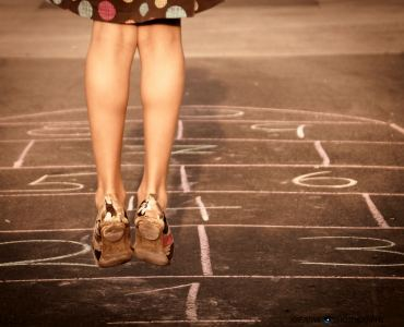 girl playing a game of hopscotch