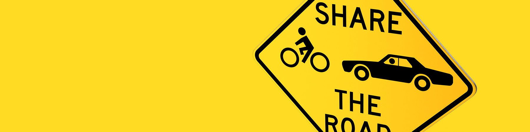 yellow and black diamond share the road sign