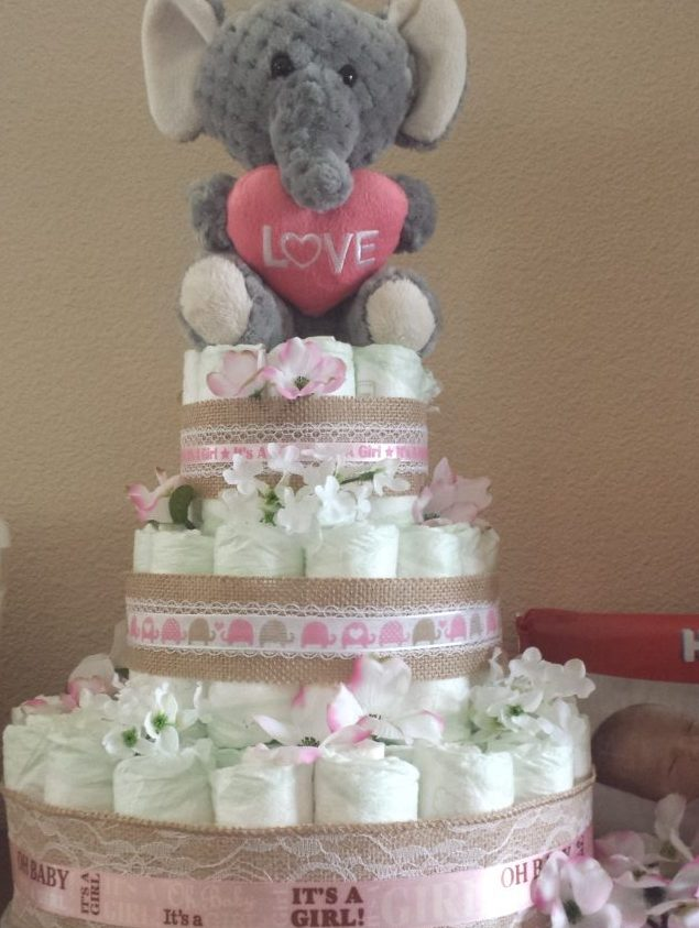Easy step by step diaper cake instructions motherhood beyond creating the diaper cake publicscrutiny Image collections
