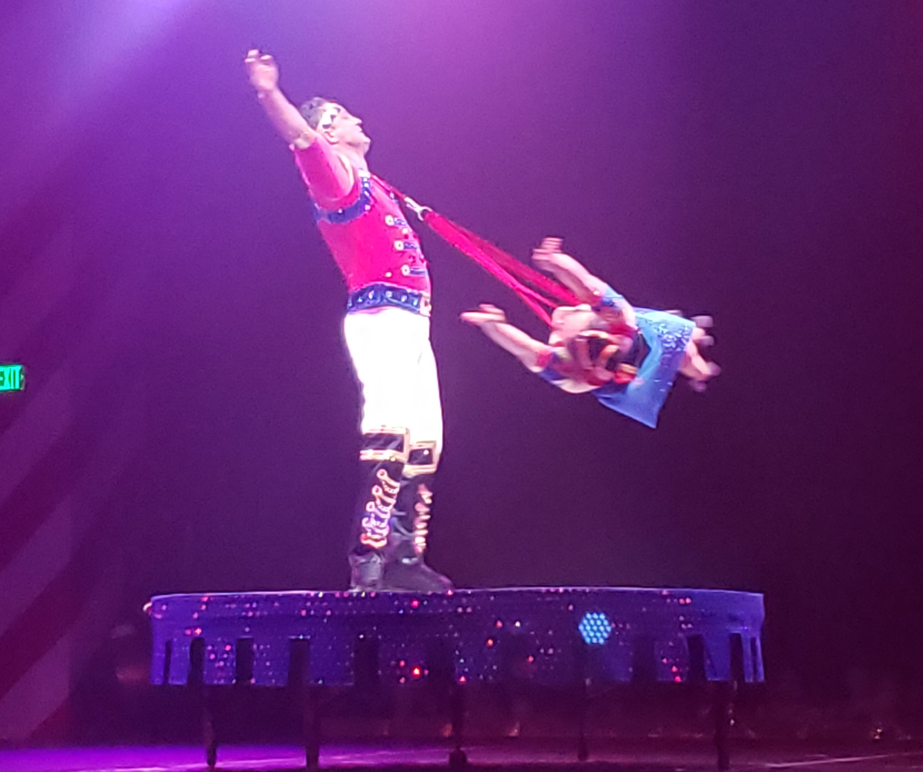 Cirque performers swinging on skates at Christmas at Gaylord of the Rockies
