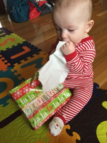 See? Eating the wrapping paper. Yep. ©Motherhood & Everything Else