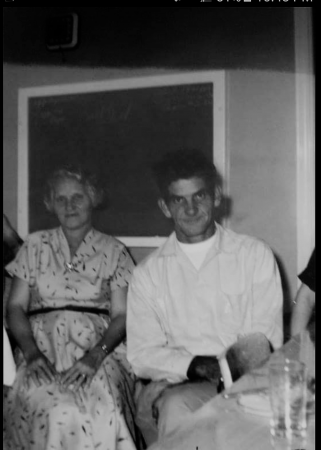 Grandma's brother, Ted, and his wife, in 1958 in front of the blackboard, three years after the house was built