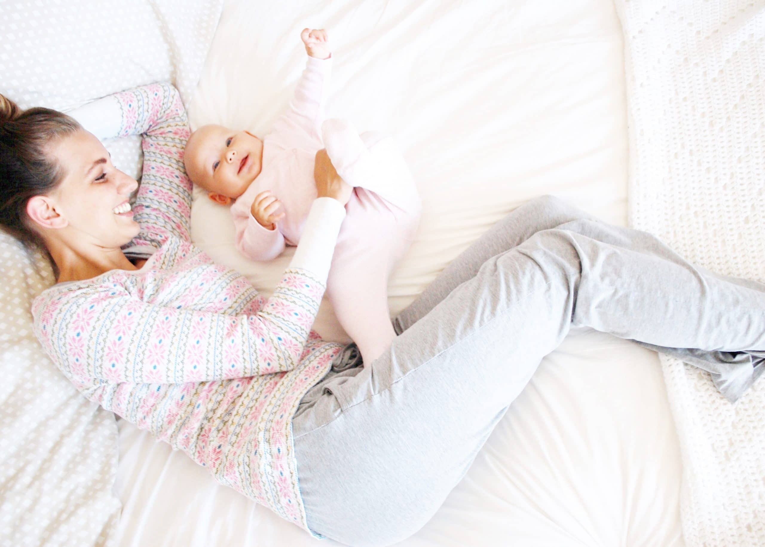 Co-sleeping with Lily smiling and foot up
