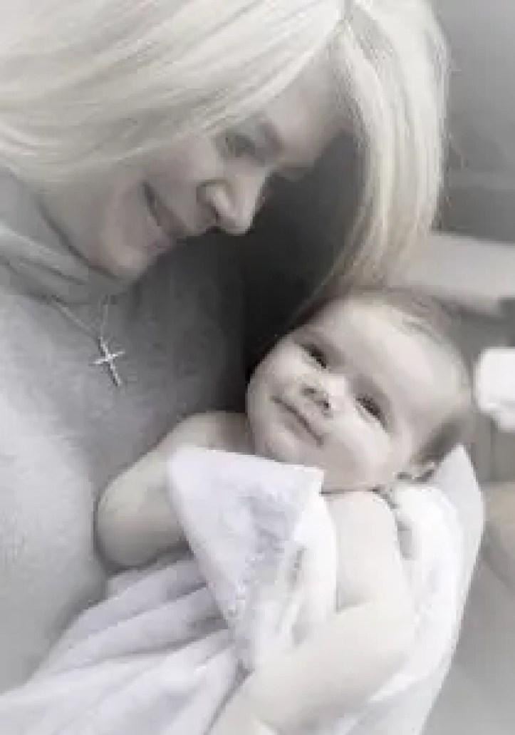 emotional mum holding baby