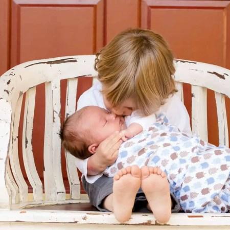 older siblings at the birth