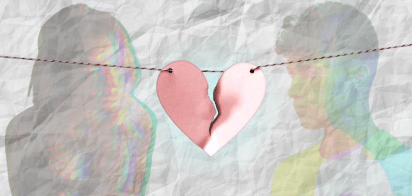 Two sad teens look look at each other longingly after a break-up. A broken paper heart hangs on a string between them.