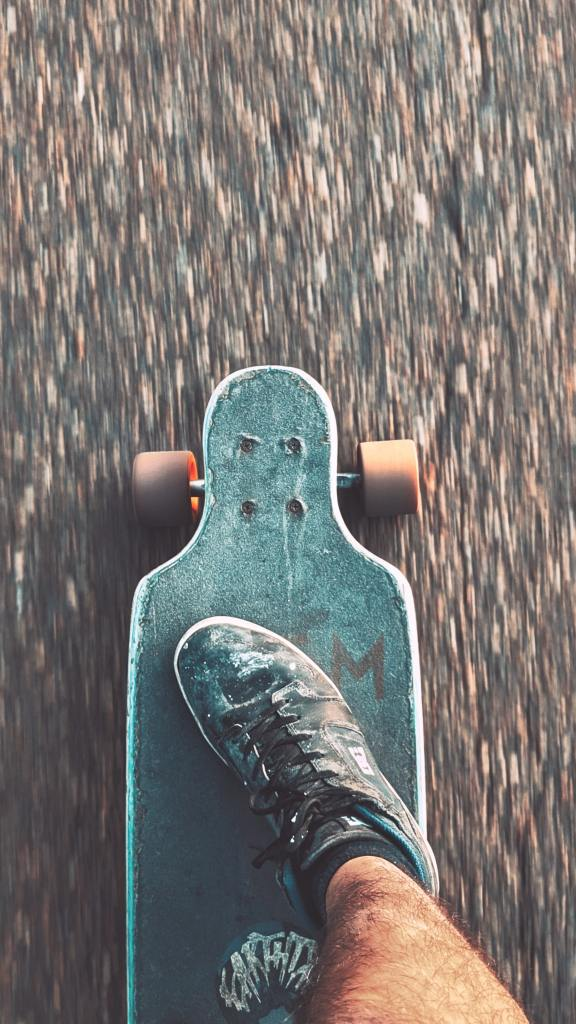 This teen riding a skateboard is exercising - an effective coping strategy for teens who struggle with self harm
