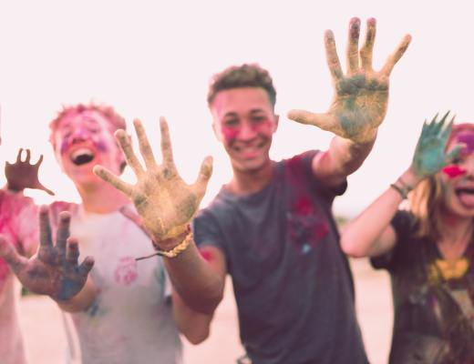 Teens get messy outside with colored chalk.