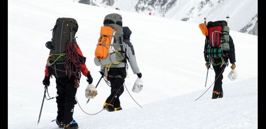 Climbers on the West Buttress route coming down from the Denali high camp at 17,000 carrying their waste off the mountain.