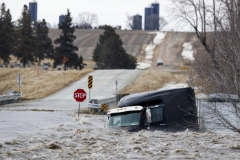 midwest flooding submerged truck