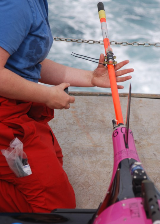 Photo of Scottish Association for Marine Science technician Karen Wilson performs final preparation of a Seaglider prior to deployment. Iceland Basin, July 2014. Source: Heather Furery, Woods Hole Oceanographic Institution