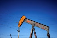 An oil well pump jack is seen at an oil field supply yard near Denver, Colorado, U.S., Feb. 2, 2015. (Credit: Reuters/Rick Wilking) Click to Enlarge.