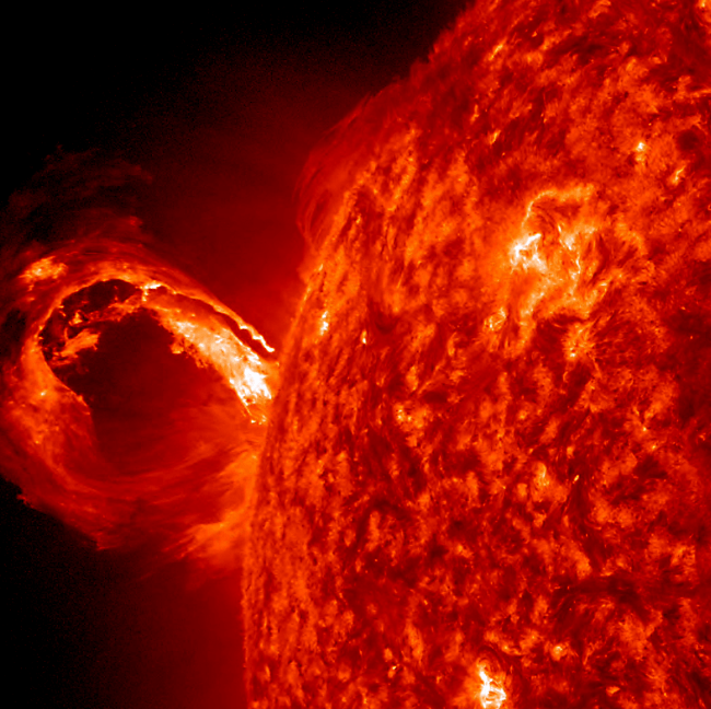 Patchy orange-red sun on right with horseshoe-shaped flare coming out to the left.