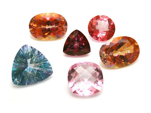 Red-orange, blue, maroon, deep yellow, red, lavender gems. Oval, triangular, round, and square.
