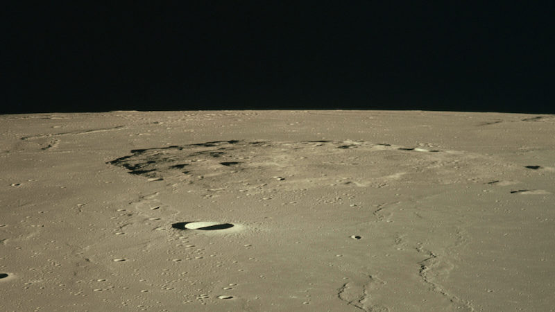 The Mons Rumker plain is pictured with a concentration of thirty lunar domes, which are rounded bulges across the top, some of which contain a small craterlet at the peak on the lunar surface.
