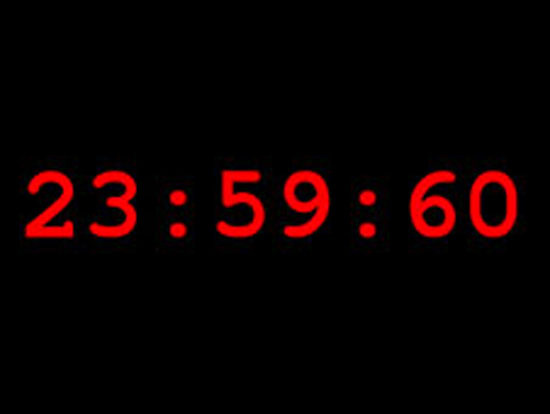 Digital clock with red numerals 23:59:60.