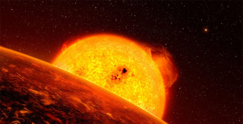 Orbital view of enormous sun rising from behind a planet with a red, scorched surface.