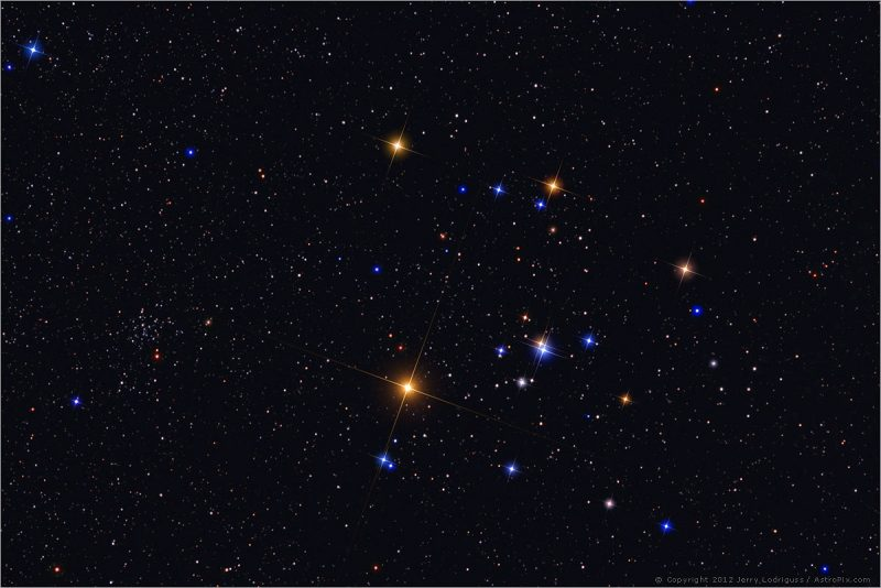 5 bright stars in V shape, one of them double, on a star field.