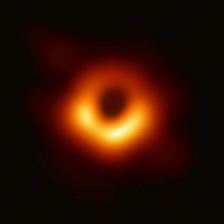 A an orange ball of light, with a black ball of light at its center.