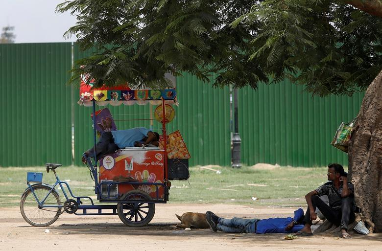 A vendor rests on his ice cream cart on a hot summer day in New Delhi