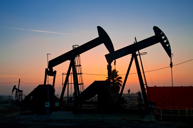 Hydraulic fracking pumps at sunset