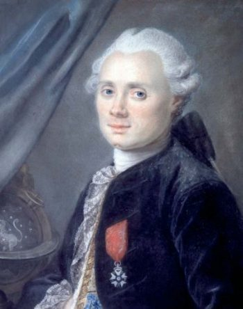 18th century man in white wig and lacy shirt.