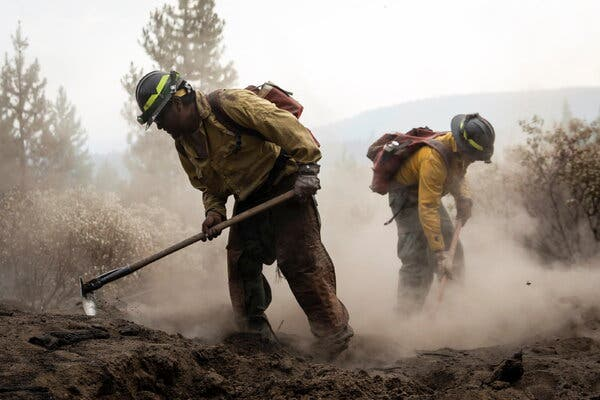 Firefighters worked to contain the Bootleg Fire near Silver Lake, Ore., last week. It has burned more than 400,000 acres and was 84 percent contained on Tuesday morning.