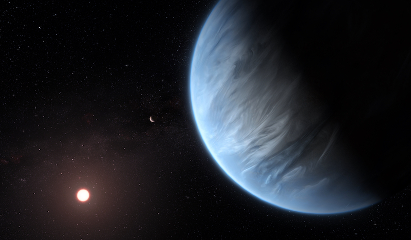 Large bluish planet with wispy clouds in its atmosphere and sun in distance.