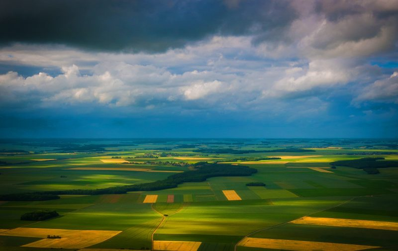 The 2021 IPCC report: View of green and yellow fields from above.